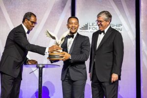 John Legend receiving award.